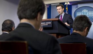 White House press secretary Josh Earnest speaks during his daily news briefing at the White House in Washington, Wednesday, Oct. 22, 2014, where he spoke about the shootings in Canada and answered questions about Ebola. (AP Photo/Jacquelyn Martin)
