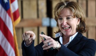 U.S. Sen. Kay Hagan talks to supporters during a campaign stop at Sharp Farms in rural Wilson County, N.C., Tuesday, Oct. 21, 2014. Hagan the Democratic incumbent will face Thom Tillis in November's general election. (AP Photo/The Wilson Times, Brad Coville)