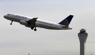 In this April 23, 2013, file photo, a United Airlines jet departs Seattle-Tacoma International Airport in Seattle. United Continental Holdings Inc. reports quarterly financial results on Thursday, Oct. 23, 2014. (AP Photo/Elaine Thompson, File)