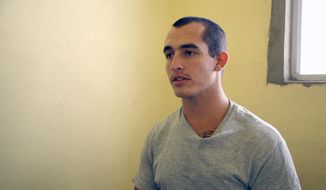 This May 3, 2014, photo shows Sgt. Andrew Tahmooressi left, who is being held at Tijuana's La Mesa Penitentiary. His lawyer is relying on the argument to win his freedom in the shortest time possible: He needs to be release so he can go home to get treatment for his combat-related post-traumatic stress, which Mexican authorities don't treat, even in their own soldiers. (AP Photo/UT San Diego, Alejandro Tamayo)