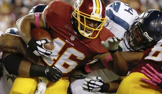 Washington Redskins running back Alfred Morris (46) carries the ball during the first half of an NFL football game against the Seattle Seahawks in Landover, Md., Monday, Oct. 6, 2014. (AP Photo/Alex Brandon)