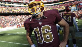 Washington Redskins quarterback Colt McCoy (16) stands on the field after an NFL football game against the Tennessee Titans, Sunday, Oct. 19, 2014, in Landover, Md. The Redskins won 19-17. (AP Photo/Pablo Martinez Monsivais)