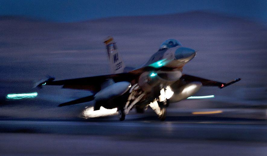 An F-16 Fighting Falcon aircraft takes off for a night mission at Nellis Air Force Base, Nev., Oct. 30, 2012. (U.S. Air Force photo by Val Gempis) ** FILE **