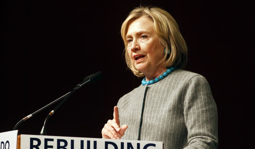 Hillary Rodham Clinton campaigns for Democratic gubernatorial nominee Gina Raimondo, not pictured, at Rhode Island College in Providence, R.I., Friday Oct. 24, 2014. (AP Photo/Stew Milne)