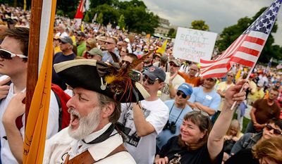 """Despite their lower profile during this election cycle and dismissal by partisan politicians and news media, the tea party remains a """"powerful force"""" in politics, according to Frank Newport, director of Gallup. (Andrew Harnik/The Washington Times)"""