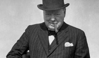 In this photo provided by the British government, Britain's Prime Minister Winston Churchill tries a Tommy Gun during a visit to north-east England, Aug. 1, 1940, to inspect coastal fortifications and defence works. The background behind Churchill has been blotted out by the censor. (AP Photo/British Official Photo)
