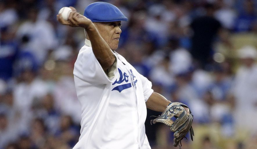 Former Los Angeles Dodgers shortstop Maury Wills throws a ceremonial first pitch before Game 2 of baseball's NL Division Series between the Dodgers and the St. Louis Cardinals in Los Angeles, Saturday, Oct. 4, 2014. (AP Photo/Jae C. Hong)