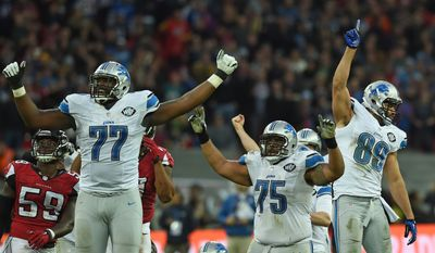 Detroit Lions players celebrate after kicker Matt Prater (5) kicked the match winning field goal during the NFL football game against Atlanta Falcons at Wembley Stadium, London, Sunday, Oct. 26, 2014.  (AP Photo/Tim Ireland)