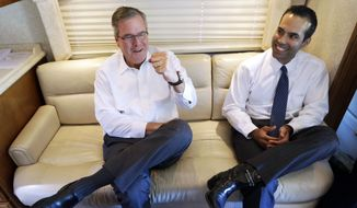"This Oct. 14, 2014, file photo shows George P. Bush reacting as his dad, former Florida Gov. Jeb Bush, left, gives a fist pump during an interview in Abilene, Texas. The younger Bush said in an interview with ABC's ""This Week"" Sunday, Oct. 26, 2014, that his dad is ""moving forward"" on a potential 2016 White House run and it appears more likely he'll join the Republican presidential field. The former Florida governor declined to run for president in 2012 despite encouragement from Republicans. (AP Photo/LM Otero, File) ** FILE **"