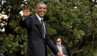President Barack Obama leaving the White House to board the Marine One helicopter in Washington in this Oct. 1, 2014, file photo. (AP Photo/Jacquelyn Martin, File)