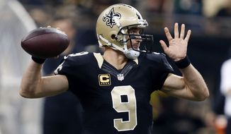 New Orleans Saints quarterback Drew Brees (9) passes in the first half of an NFL football game against the Green Bay Packers in New Orleans, Sunday, Oct. 26, 2014. (AP Photo/Rogelio Solis)