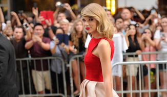 """Taylor Swift attends the world premiere of """"The Giver"""" at the Ziegfeld Theatre in New York in this Aug. 11, 2014, file photo. (Photo by Evan Agostini/Invision/AP, File)"""