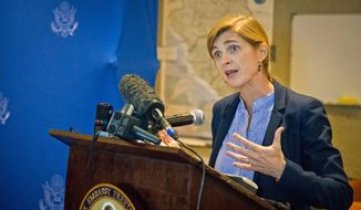 "American ambassador to the United Nations Samantha Power speaks to media in the city of  Freetown , Sierra Leone, Monday, Oct. 27, 2014. The United States will help fight Ebola over ""the long haul,"" the American ambassador to the United Nations said on a trip to the West African countries hit by the outbreak. Samantha Power, who is visiting Sierra Leone on Monday, met Sunday with religious leaders in Guinea, where the Ebola outbreak was first identified in March.  (AP Photo/ Michael Duff)"