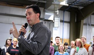 Wisconsin Gov. Scott Walker speaks to employees of Vortex Optics in Middleton, Wis. during a campaign stop at the manufacturing business, Monday, Oct. 27, 2014. Walker is running for re-election against Democratic challenger Mary Burke. (AP Photo/John Hart, Wisconsin State Journal)