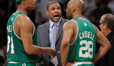 Boston Celtics' coach Doc Rivers talks with Paul Pierce and Sam Cassell in the second half of Game 5 of the NBA basketball finals against the Los Angeles Lakers Sunday, June 15, 2008, in Los Angeles. (AP Photo/Kevork Djansezian)