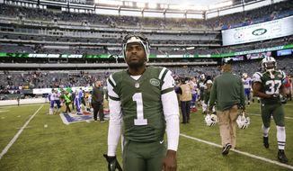 New York Jets quarterback Michael Vick (1) walks off the field after an NFL football game against the Buffalo Bills, Sunday, Oct. 26, 2014, in East Rutherford, N.J. The Bills won the game 43-23. (AP Photo/Seth Wenig)