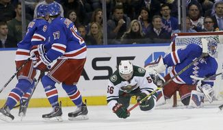 Minnesota Wild's Erik Haula (56) falls down after being hit by New York Rangers' John Moore (17) during the second period of an NHL hockey game Monday, Oct. 27, 2014, in New York. Moore was given a match penalty on the hit. (AP Photo/Frank Franklin II)