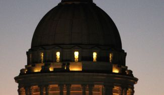 In this Thursday, Nov. 10, 2011, file photo, the dome of the Oklahoma Capitol is illuminated as the sky darkens in Oklahoma City. (AP Photo/Sue Ogrocki, file)