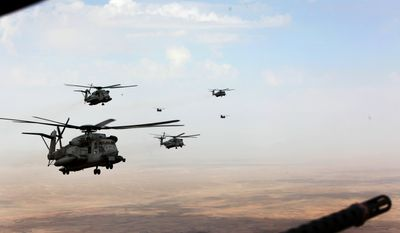 Marine Corps and Royal Air Force helicopters fly in formation after departing Camp Bastion, Afghanistan, Oct. 27, 2014. The Marine Corps ended operations in Helmand province and transferred the base to the Afghan National Army.