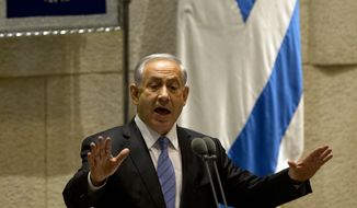 "Israel's Prime Minister Benjamin Netanyahu speaks during the opening session of the Knesset, Israel's parliament, in Jerusalem, Monday, Oct. 27, 2014. Netanyahu told parliament Monday that ""the French build in Paris, the English build in London and the Israelis build in Jerusalem."" The government is currently advancing construction plans to build about 1,000 housing units in east Jerusalem. The Palestinians seek east Jerusalem as their future capital and oppose any Israeli construction there. The international community, including the United States, does not recognize Israel's annexation of the eastern sector of Jerusalem. (AP Photo/Ariel Schalit)"