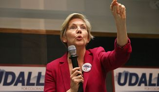 In this Oct. 17, 2014, file photo, Sen. Elizabeth Warren, D-Mass., speaks to a crowd during a rally to urge the re-election of Colo. Sen. Mark Udall to the Senate, on the campus of the University of Colorado, in Boulder, Colo. (AP Photo/Brennan Linsley, File)