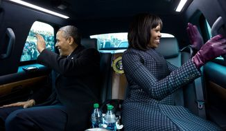 """Jan. 2, 2013 """"The President and First Lady wave to supporters as they ride in the inaugural parade. I had asked the President if I could ride in the presidential limousine and the President joked, 'But Michelle and I were planning to make out.'""""  (Official White House Photo by Pete Souza)  This official White House photograph is being made available only for publication by news organizations and/or for personal use printing by the subject(s) of the photograph. The photograph may not be manipulated in any way and may not be used in commercial or political materials, advertisements, emails, products, promotions that in any way suggests approval or endorsement of the President, the First Family, or the White House."""
