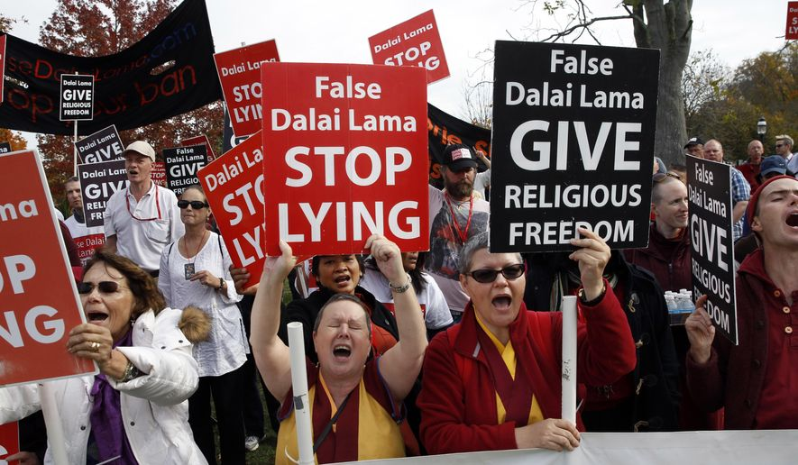 CORRECTS SPELLING OF DALAI LAMA - A group of protesters chant and shout outside Princeton University's Jadwin Gymnasium where the Dalai Lama was speaking Tuesday, Oct. 28, 2014, in Princeton, N.J. The protesters claim The Dalai Lama discriminated against followers of a 400-year-old religious tradition of praying to the Buddhist Deity Dorje Shugden. (AP Photo/Mel Evans)