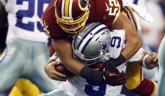 Dallas Cowboys quarterback Tony Romo (9) is sacked by Washington Redskins inside linebacker Keenan Robinson (52) during the second half of an NFL football game, Monday, Oct. 27, 2014, in Arlington, Texas. Romo suffered an injury during the play. (AP Photo/Tim Sharp)