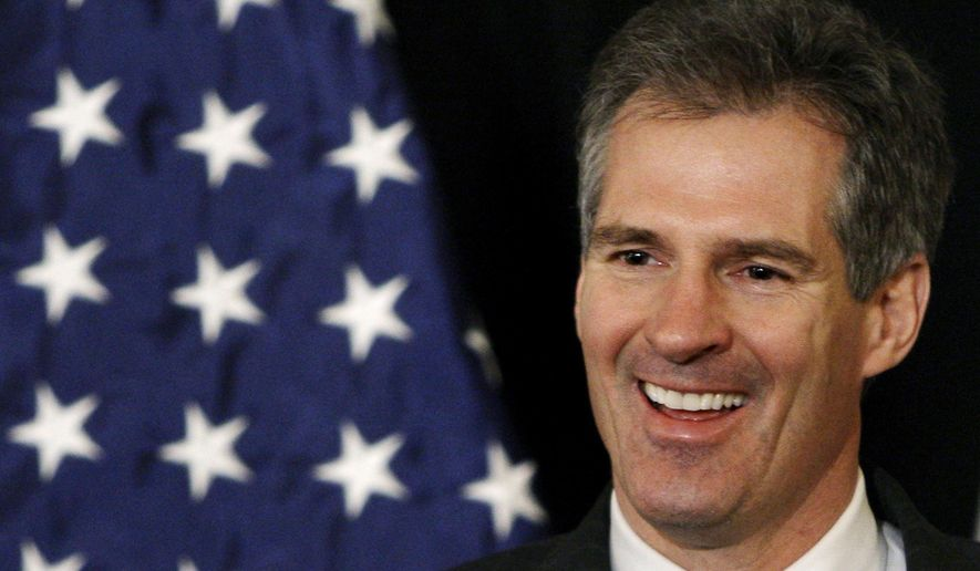 This Jan. 20, 2010, file photo shows then U.S. Sen.-elect Scott Brown, R-Mass., smiling as he addresses reporters during a news conference at the Park Plaza hotel in Boston. (AP Photo/Charles Krupa, File)