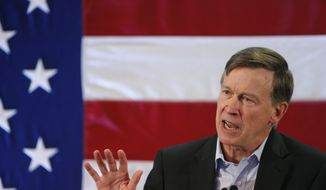 Colorado Gov. John Hickenlooper speaks during a rally at which former President Bill Clinton urged Coloradans to reelect Gov. Hickenlooper, U.S. Sen. Mark Udall, and other Democratic candidates, in Lakewood, Colo., Tuesday, Oct. 28, 2014. Clinton held his second rally in two days for embattled Gov. Hickenlooper and Sen. Udall. The former president told a crowd in Lakewood that Colorado symbolizes the future due to its diversity and youth. (AP Photo/Brennan Linsley)