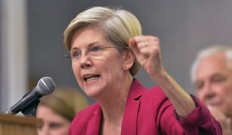 Massachusetts Sen. Elizabeth Warren speaks to supporters during a rally for Kentucky senatorial candidate Alison Lundergan Grimes at the International Brotherhood of Electrical Workers Local Union 369 meeting hall in Louisville, Ky., Tuesday, Oct. 28, 2014. (AP Photo/Timothy D. Easley) ** FILE **