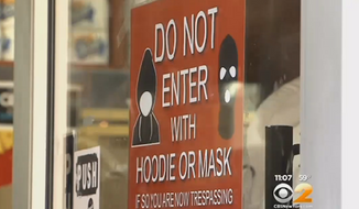 Several businesses in New York City's Harlem neighborhood have posted signs banning hoodies and face masks in order to deter crime. (CBS New York)