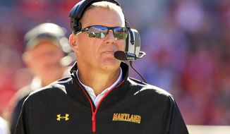 Maryland coach Randy Edsall watches during the second half of an NCAA college football game against Wisconsin, Saturday, Oct. 25, 2014, in Madison, Wis. Wisconsin won 52-7. (AP Photo/Andy Manis)