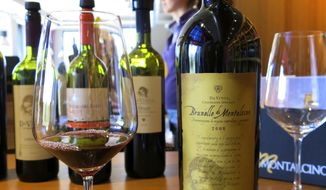 This June 13, 2014, photo shows bottles of wine at Cantina di Montalcino, a winery in the town of Montalcino in Tuscany, Italy. (AP Photo/Karen Schwartz)
