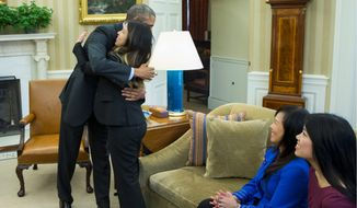 Not allowing reporters or TV cameras in the Oval Office Oct. 24 when President Obama hugged Ebola survivor Nina Pham showed a lack of transparency. (Associated Press)