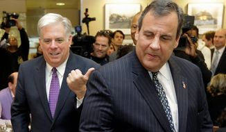 New Jersey Gov. Chris Christie made his third trip to Maryland to support fellow Republican Larry Hogan (left), who is hoping to become only the second GOP governor to lead Maryland since 1969. Mr. Christie, a potential 2016 presidential candidate, will make his fourth trip to Maryland on Sunday. (Associated Press)