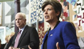 U.S. Sen. John McCain, left, and Iowa Republican senatorial candidate Joni Ernst speak to a packed cafe about  veterans and voter turn out during a campaign stop, Wednesday Oct. 29, 2014, at Ivy Bake Shoppe & Cafe in West Burlington, Iowa. (AP Photo/The Hawk Eye, Michael Noble Jr.)