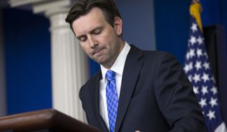 White House press secretary Josh Earnest pauses as he answers a question during the daily press briefing at the White House in Washington on Oct. 29, 2014. (Associated Press) **FILE**