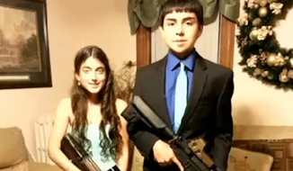 Tito Velez, 15, and his girlfriend Jamie Pereira were suspended and face possible expulsion after posting a homecoming photo of themselves holding Airsoft rifles online. (CBS Boston)