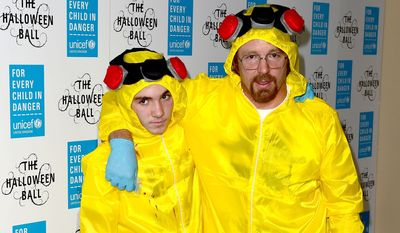 """Filmmaker Guy Ritchie and his son Rocco go with the """"Breaking Bad"""" trend this Halloween, just one of the costumes that push the boundaries of taste. (Associated Press)"""
