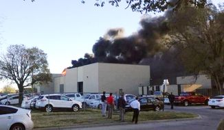 In the image from video provided by KAKE News black smoke billows from a building at Mid-Continent Airport where officials say a plane crashed Thursday, Oct. 30, 2014 in Wichita, Kan. AP Photo/KAKE News)