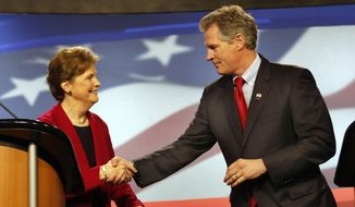 Democrat, U.S. Sen Jeanne Shaheen, left, shakes hands with her Republican opponent former Massachusetts U.S. Sen. Scott Brown before a live televised debate for U.S. Senate hosted by WMUR, the New Hampshire Union Leader, and The New Hampshire Institute of Politics at Saint Anselm College, Thursday, Oct. 30, 2014 in Manchester, NH (AP Photo/Jim Cole)