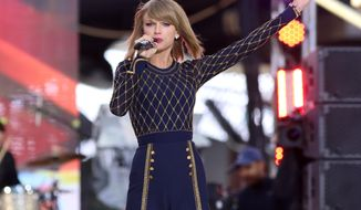 "Taylor Swift performs on ABC's ""Good Morning America"" in Times Square on Thursday, Oct. 30, 2014, in New York. (Photo by Greg Allen/Invision/AP)"
