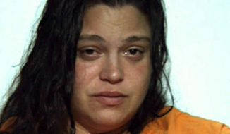 Suspect Nikole Ardeno is a community organizer with a local Stop the Violence group and has been charged along with Emanuel Velez with severely beating a former roommate with whom they had a property dispute on Tuesday. (AP Photo/Washington County Jail )
