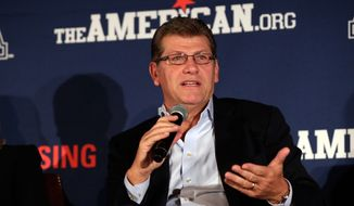 UConn head coach Geno Auriemma is interviewed during the American Athletic Conference women's NCAA college basketball media day, in New York,  Thursday, Oct. 30, 2014. (AP Photo/Richard Drew)