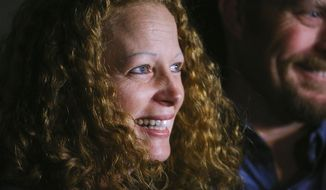 Kaci Hickox, a nurse who treated Ebola patients in West Africa, and boyfriend Ted Wilbur take questions from the media outside her home in Fort Kent, Maine on Wednesday, Oct. 29, 2014. Hickox, the first person forced into New Jersey's mandatory quarantine for people arriving at the Newark airport from three West African countries, vowed to defy Maine's voluntary quarantine . (AP Photo/Portland Press Herald, Whitney Hayward)