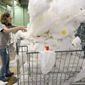 In this photo taken on Sept. 17, 2014, Elaine Timms, an employee of Phoenix of Anderson, sorts fabrics inside the company's warehouse in Williamston. S.C. The Commerce Department releases third-quarter gross domestic product on Thursday, Oct. 30, 2014. (AP Photo/Anderson Independent Mail, Nathan Gray)