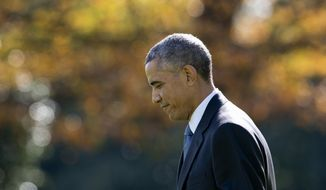 President Barack Obama walks across the South Lawn of the White House in Washington, Thursday, Oct. 30, 2014, to board Marine One for the short trip to Andrews Air Force Base then onto Maine for Democratic National Committee and campaign events. (AP Photo/Carolyn Kaster)