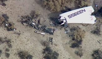 This image from video by KABC TV Los Angeles shows wreckage of what is believed to be SpaceShipTwo in Southern California's Mojave Desert on Friday, Oct. 31, 2014. A Virgin Galactic space tourism rocket exploded after taking off on a test flight, a witness said Friday. (AP Photo/KABC TV)