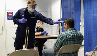 "In this Thursday, Oct. 16, 2014, photo released by U.S. Customs and Border Protection, U.S. Coast Guard Health Technician Nathan Wallenmeyer, left, and CBP supervisor Sam Ko conduct prescreening measures on a passenger, right, who arrived from Sierra Leone at O'Hare International Airport's Terminal 5 in Chicago. Canada has joined Australia in suspending entry visas for people from Ebola-stricken countries in West Africa in an attempt to keep the deadly disease away. Canada's Conservative government said Friday, Oct. 31, 2014, it is suspending visa applications for residents and nationals of countries with ""widespread and persistent-intense transmission"" of Ebola virus disease. (AP Photo/U.S. Customs and Border Protection, Melissa Maraj, File) **FILE**"
